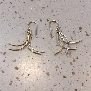 Ladies gold dangle earrings.